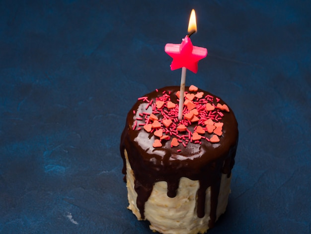Cream cheese cake with chocolate glaze, sprinkles