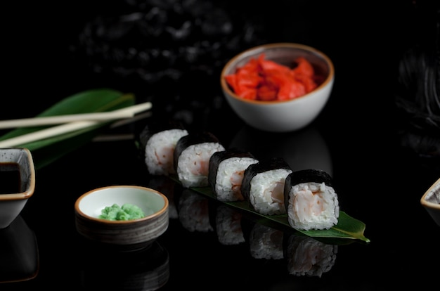 Cream cheese sushi rolls with ginger on a leaf