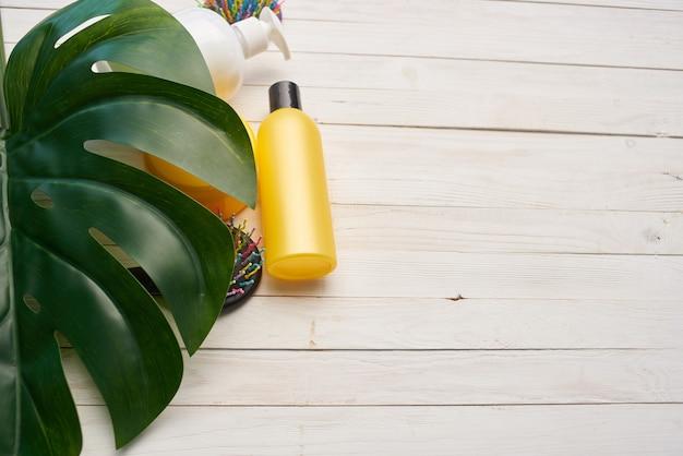 Cream cosmetics skin care green leaf wood background. high quality photo
