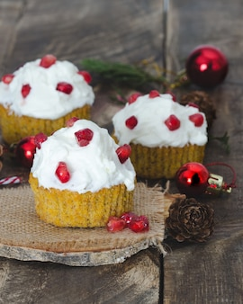 Cream cupcakes with christmas decorations