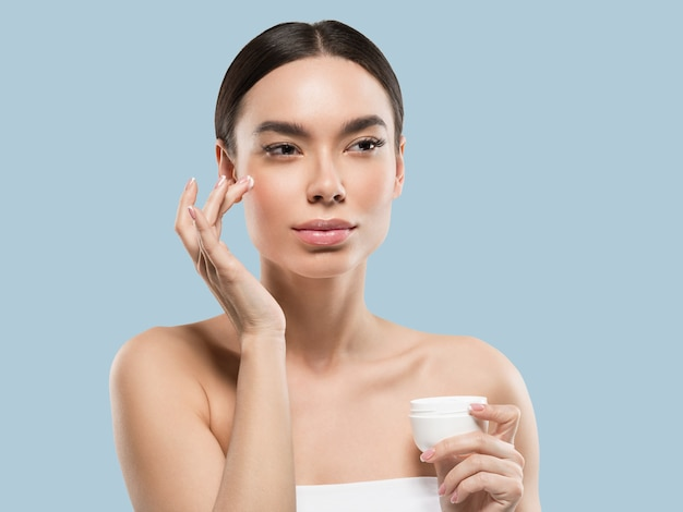 Cream face woman cosmetic healthy skin care beauty portrait isolated on white color background blue
