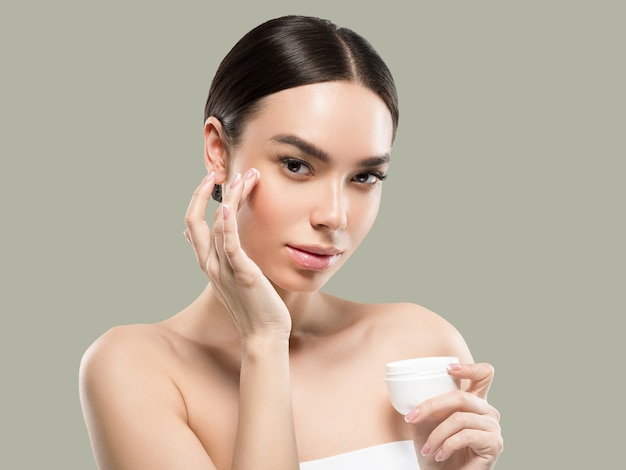 Cream face woman cosmetic healthy skin care beauty portrait isolated on white color background green