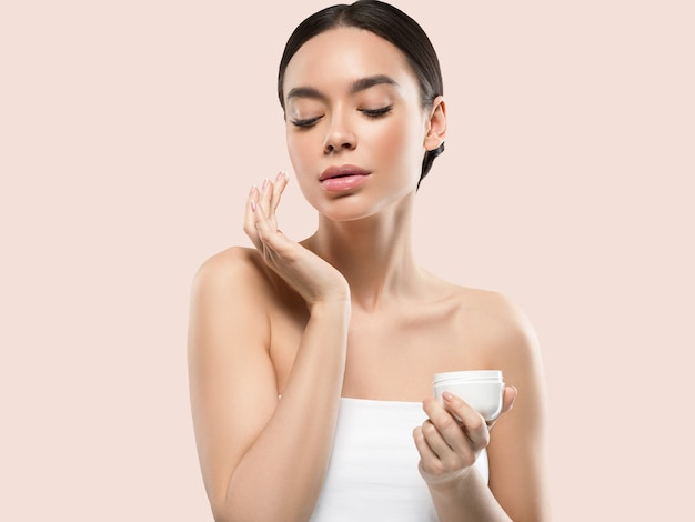 Cream face woman cosmetic healthy skin care beauty portrait isolated on white color background pink