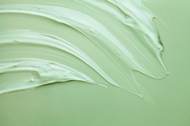 Cream gel green transparent cosmetic sample texture smudge background