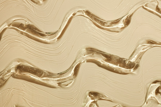 Cream gel yellow transparent cosmetic sample texture waves background