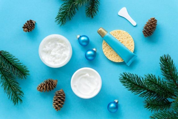 Cream and lip balm on blue