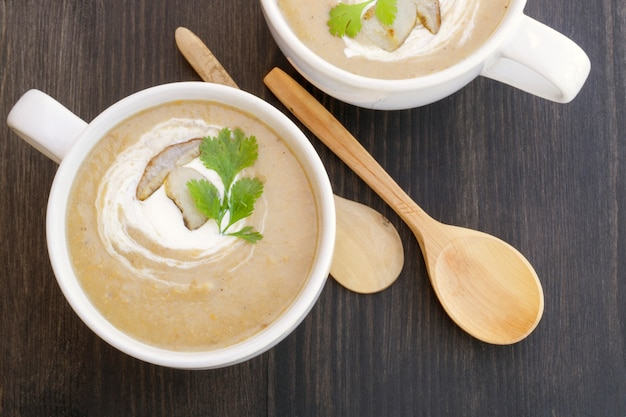 Cream of mushroom soup on a black background