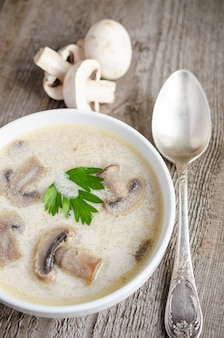 Cream of mushroom soup on wooden table