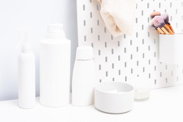 Cream and shampoo bottle on bathroom table