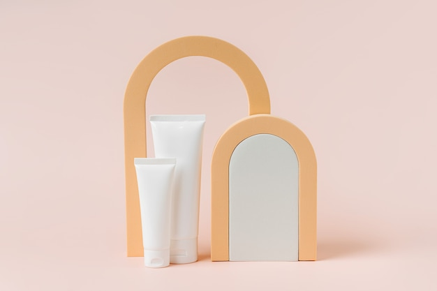 Cream tube mockup on podium with arch. background for branding and packaging presentation