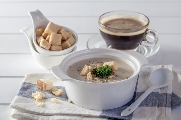 Creamy chicken and vegetables on a white wooden table