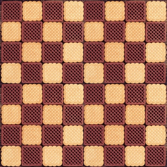 Creamy and chocolate cookies as checkerboard. can be used as background