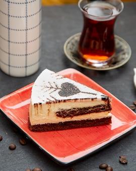 Creamy dessert and black tea served in armudu glass