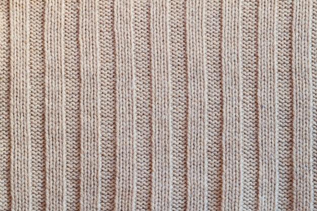 冬の生地テクスチャ背景のクリーミーなニットウール暖かい服