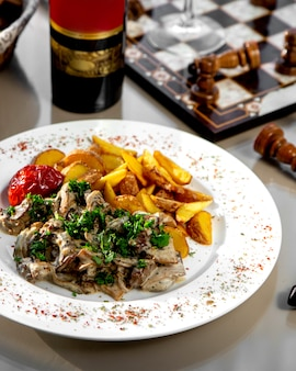 Creamy mushroom topped with herbs and fried potatoes
