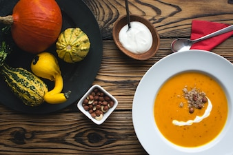 Creamy pumpkin soup with cream and hazelnuts