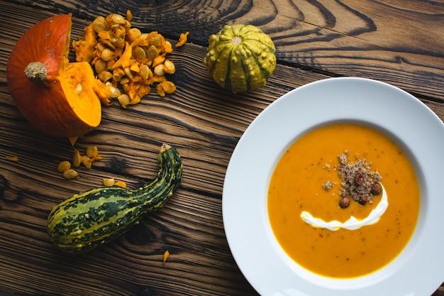 Creamy pumpkin soup with cream and hazelnuts