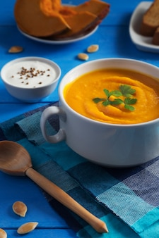 Creamy pumpkin soup with seeds and parsley