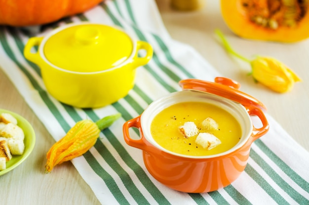 Creamy pumpkin soup with vegetables, seeds and croutons.