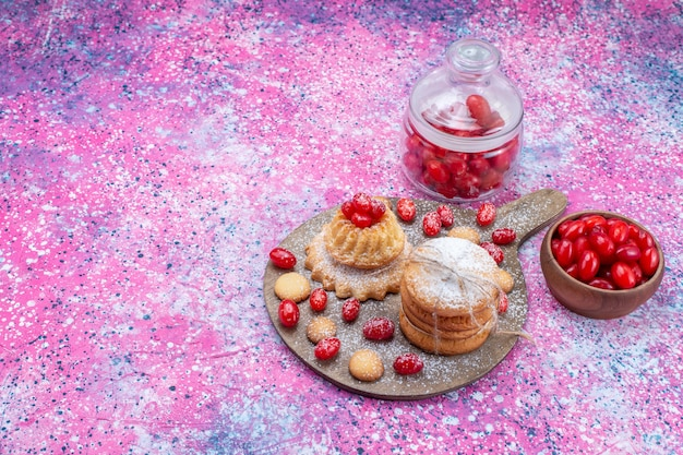 Creamy sandwich cookies with red dogwoods dogwood juice on bright, cookie cake biscuit sweet sour fruit berry