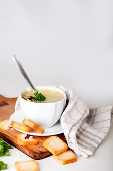 Creamy soup with croutons