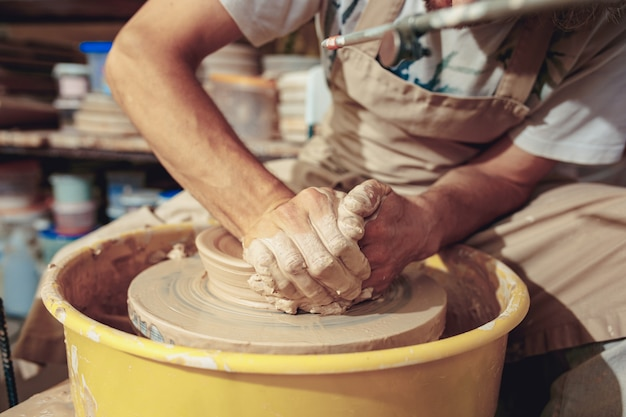 Creating a jar or vase of white clay close-up