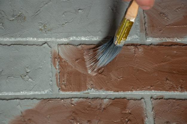 Creation of artificial bricks the process of painting a photographic background with colored paints