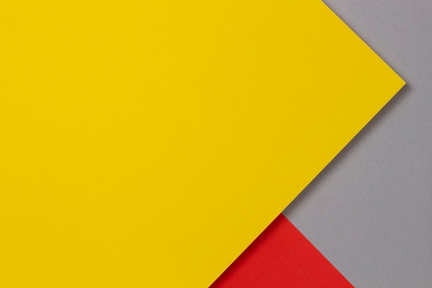 Creative abstract yellow, red and gray color geometric paper compositon wall, top view