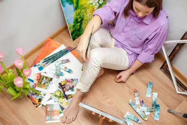 Creative artist painting in the studio