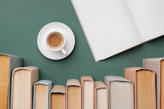 Creative assortment with different books and a cup of cofee