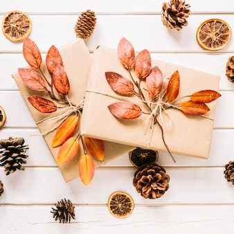 Creative autumn composition with gifts on white background