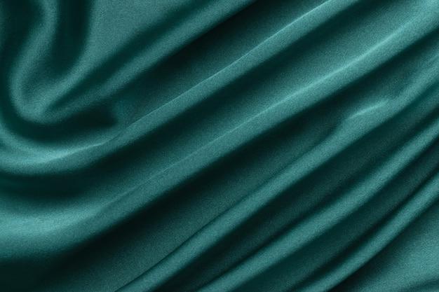 녹색 실크의 크리 에이 티브 배경입니다. 추상 텍스처입니다.