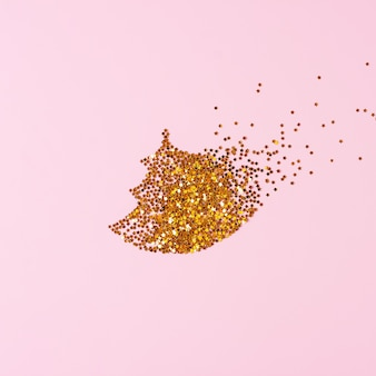 Creative background with christmas tree made from confetti on pink