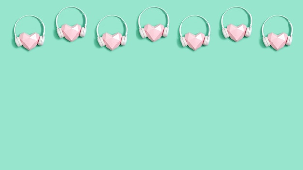 Creative banner with tender pink polygonal paper heart shape in white headphones music concept