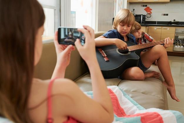 Creative boy playing guitar