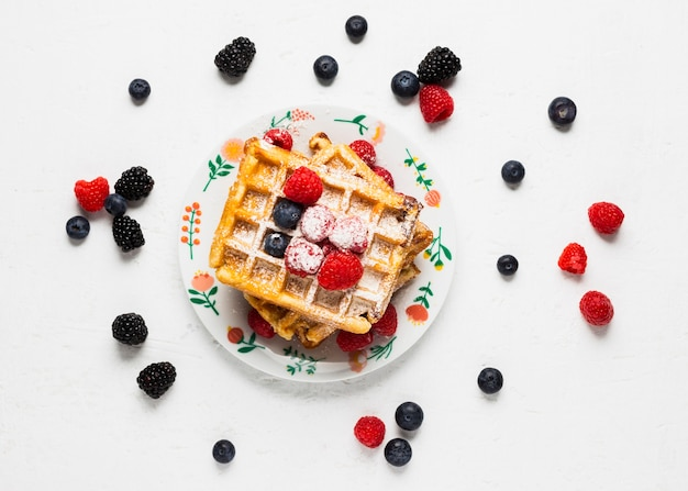 Creative breakfast with waffles and wild berries