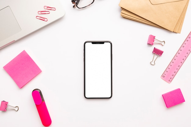 Creative business arrangement on white background with empty phone
