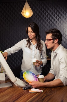 Creative business people working with colour samples