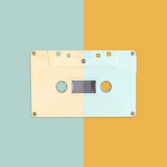 Creative cassette tape on pastel color background.