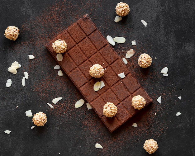 Creative chocolate composition on dark background