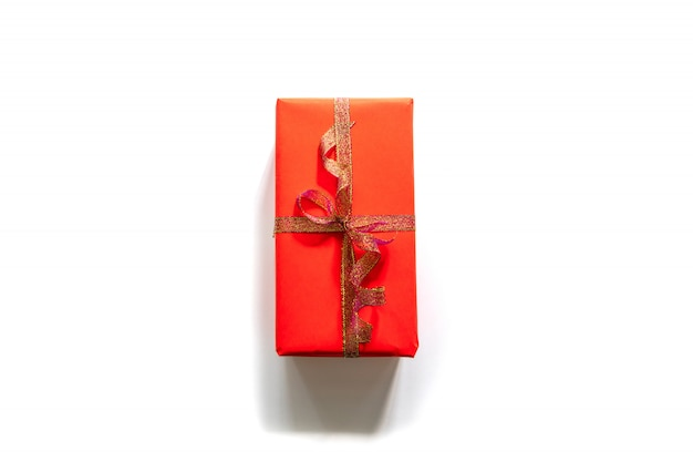 Creative christmas composition of gift box with gold tape on white . top view with copyspace.