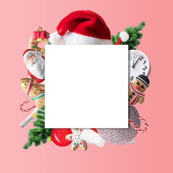 Creative christmas composition made of christmas winter decoration with paper card note