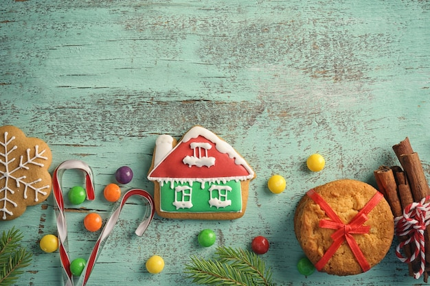 Creative christmas cookies on wooden table