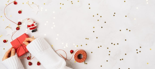 Creative christmas layout on white background with confetti and space for text.
