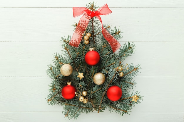 Creative christmas tree on white background with festive decorations balls, new year. flat lay