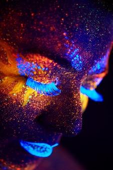 Creative close up uv portrait with hot sun and stars, red yellow blue orange art