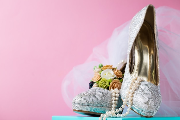 Creative composition of bridal lace shoes