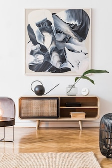 Creative composition of cozy and stylish living room interior design with frame, wooden commode and accessories. white walls. minimalistic concept. neutral colors.
