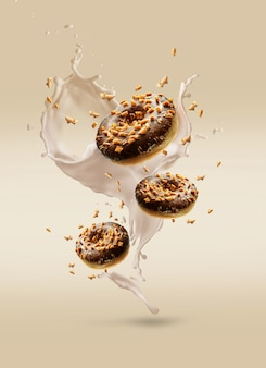Creative composition of flying donuts with cream splashes