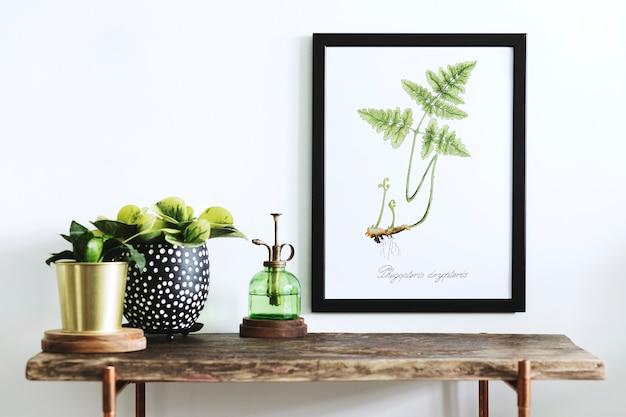 Креативная композиция домашнего интерьера с рамкой для плаката, деревянной консолью, растениями в хипстерских горшках и аксессуарами.